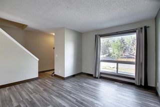 Photo 11: 72 DEERPOINT Road SE in Calgary: Deer Ridge Row/Townhouse for sale : MLS®# A1029747