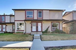 Photo 2: 72 DEERPOINT Road SE in Calgary: Deer Ridge Row/Townhouse for sale : MLS®# A1029747