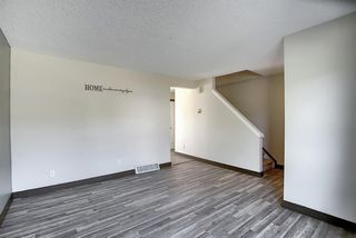 Photo 12: 72 DEERPOINT Road SE in Calgary: Deer Ridge Row/Townhouse for sale : MLS®# A1029747