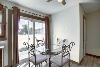 Photo 9: 72 DEERPOINT Road SE in Calgary: Deer Ridge Row/Townhouse for sale : MLS®# A1029747