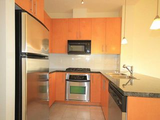 "Photo 5: 416 3551 FOSTER Avenue in Vancouver: Collingwood VE Condo for sale in ""FINALE WEST"" (Vancouver East)  : MLS®# V1043674"