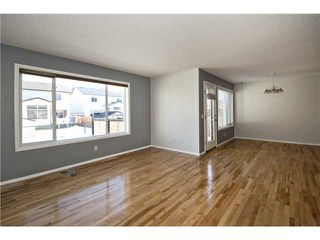 Photo 8: 113 COUGARSTONE Place SW in CALGARY: Cougar Ridge Residential Attached for sale (Calgary)  : MLS®# C3598233