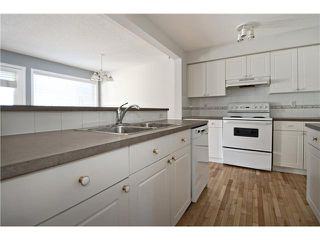 Photo 3: 113 COUGARSTONE Place SW in CALGARY: Cougar Ridge Residential Attached for sale (Calgary)  : MLS®# C3598233