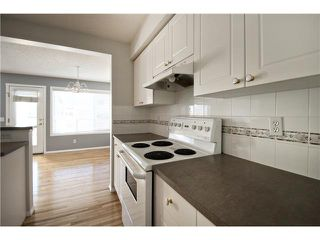 Photo 4: 113 COUGARSTONE Place SW in CALGARY: Cougar Ridge Residential Attached for sale (Calgary)  : MLS®# C3598233