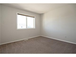 Photo 11: 113 COUGARSTONE Place SW in CALGARY: Cougar Ridge Residential Attached for sale (Calgary)  : MLS®# C3598233