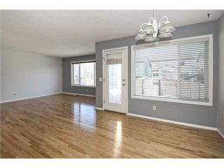 Photo 6: 113 COUGARSTONE Place SW in CALGARY: Cougar Ridge Residential Attached for sale (Calgary)  : MLS®# C3598233