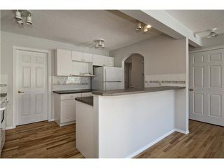 Photo 5: 113 COUGARSTONE Place SW in CALGARY: Cougar Ridge Residential Attached for sale (Calgary)  : MLS®# C3598233