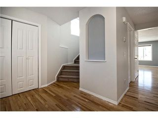 Photo 2: 113 COUGARSTONE Place SW in CALGARY: Cougar Ridge Residential Attached for sale (Calgary)  : MLS®# C3598233