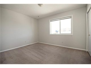 Photo 13: 113 COUGARSTONE Place SW in CALGARY: Cougar Ridge Residential Attached for sale (Calgary)  : MLS®# C3598233
