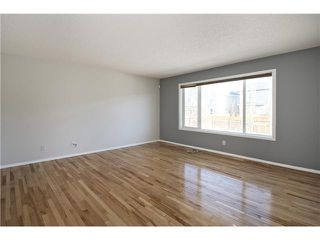 Photo 7: 113 COUGARSTONE Place SW in CALGARY: Cougar Ridge Residential Attached for sale (Calgary)  : MLS®# C3598233