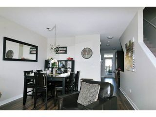 "Photo 4: 102 1480 SOUTHVIEW Street in Coquitlam: Burke Mountain Townhouse for sale in ""CEDAR CREEK NORTH"" : MLS®# V1088331"