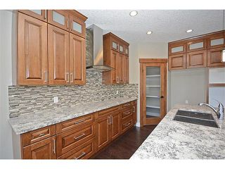 Photo 9: 408 KINNIBURGH Boulevard: Chestermere House for sale : MLS®# C4010525