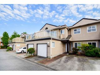 "Photo 1: 4 15875 84 Avenue in Surrey: Fleetwood Tynehead Townhouse for sale in ""ABBEY ROAD"" : MLS®# F1441481"