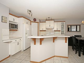 Photo 14: 78 DOUGLAS WOODS Gardens SE in Calgary: Douglasdale/Glen House for sale : MLS®# C4121688