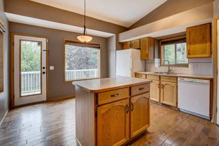 Photo 8: 152 ARBOUR RIDGE Circle NW in Calgary: Arbour Lake House for sale : MLS®# C4137863