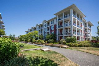 """Photo 1: 301 4600 WESTWATER Drive in Richmond: Steveston South Condo for sale in """"COPPER SKY EAST"""" : MLS®# R2343805"""