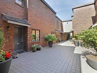 "Photo 1: 6 960 W 13TH Avenue in Vancouver: Fairview VW Townhouse for sale in ""BRICKHOUSE"" (Vancouver West)  : MLS®# R2381516"