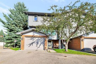 Main Photo: 21 64 WOODACRES Crescent SW in Calgary: Woodbine Row/Townhouse for sale : MLS®# A1022652