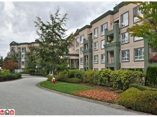 "Photo 2: 419 13880 70TH Avenue in Surrey: East Newton Condo for sale in ""Chelsea Gardens"" : MLS®# F1125041"
