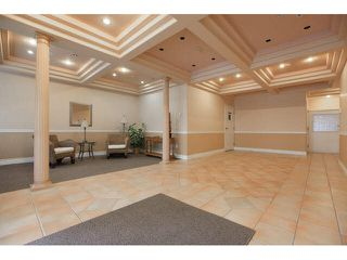 """Photo 2: 105 1630 154 Street in Surrey: King George Corridor Condo for sale in """"CARLTON COURT"""" (South Surrey White Rock)  : MLS®# F1438775"""