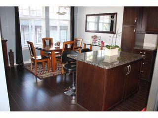 """Photo 4: 37 14462 61A Avenue in Surrey: Sullivan Station Townhouse for sale in """"RAVINA"""" : MLS®# F1444096"""