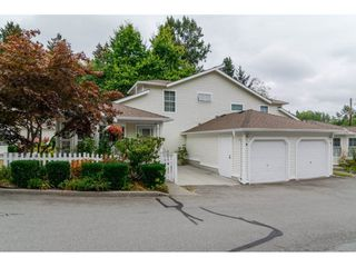 "Photo 1: 8 6537 138 Street in Surrey: East Newton Townhouse for sale in ""Charleston Green"" : MLS®# R2105934"