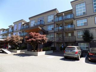 "Photo 1: 406 30525 CARDINAL Avenue in Abbotsford: Abbotsford West Condo for sale in ""Tamarind Westside"" : MLS®# R2185961"