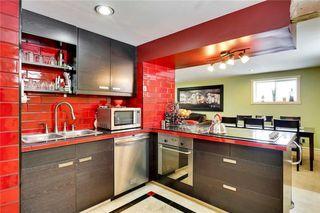 Photo 25: 49 MEADOWVIEW RD SW in Calgary: Meadowlark Park House for sale : MLS®# C4104032