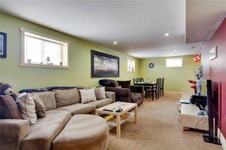 Photo 26: 49 MEADOWVIEW RD SW in Calgary: Meadowlark Park House for sale : MLS®# C4104032