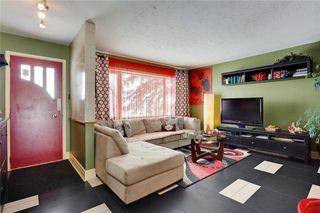 Photo 2: 49 MEADOWVIEW RD SW in Calgary: Meadowlark Park House for sale : MLS®# C4104032
