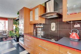 Photo 8: 49 MEADOWVIEW RD SW in Calgary: Meadowlark Park House for sale : MLS®# C4104032