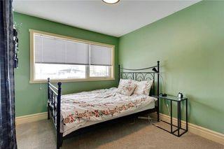 Photo 18: 49 MEADOWVIEW RD SW in Calgary: Meadowlark Park House for sale : MLS®# C4104032