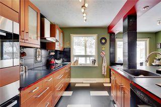 Photo 7: 49 MEADOWVIEW RD SW in Calgary: Meadowlark Park House for sale : MLS®# C4104032