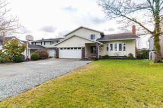 Photo 1: 19666 S WILDWOOD Crescent in Pitt Meadows: South Meadows House for sale : MLS®# R2236917