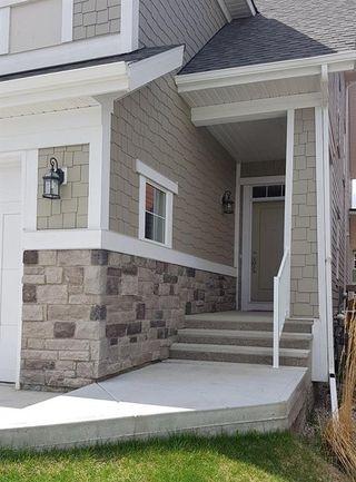Photo 2: 133 RIVIERA Crescent: Cochrane House for sale : MLS®# C4185645