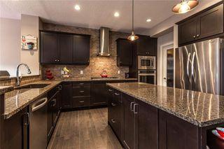 Photo 8: 133 RIVIERA Crescent: Cochrane House for sale : MLS®# C4185645