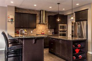 Photo 9: 133 RIVIERA Crescent: Cochrane House for sale : MLS®# C4185645