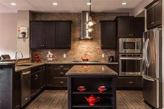 Photo 7: 133 RIVIERA Crescent: Cochrane House for sale : MLS®# C4185645