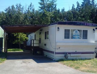 "Main Photo: 4 4200 DEWDNEY TRUNK Road in Coquitlam: Ranch Park Manufactured Home for sale in ""HIDEWAY PARK"" : MLS®# R2282330"