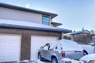 Main Photo: 31 76 Cedardale Crescent SW in Calgary: Cedarbrae Semi Detached for sale : MLS®# A1056460