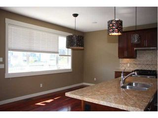 Photo 3: 142 Topaz Gate in Chestermere: Rainbow Falls Residential Detached Single Family for sale : MLS®# C3484776