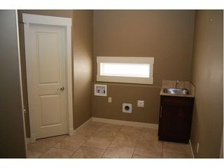 Photo 16: 142 Topaz Gate in Chestermere: Rainbow Falls Residential Detached Single Family for sale : MLS®# C3484776