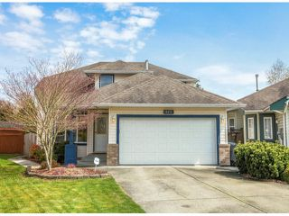 Photo 1: 18875 64TH Avenue in Surrey: Cloverdale BC House for sale (Cloverdale)  : MLS®# F1408597