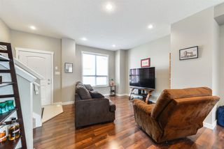 Photo 3: 10 6075 SCHONSEE Way in Edmonton: Zone 28 Townhouse for sale : MLS®# E4151628