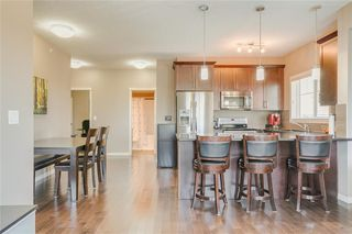 Photo 5: 2401 130 PANATELLA Street NW in Calgary: Panorama Hills Apartment for sale : MLS®# C4294912