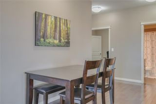 Photo 7: 2401 130 PANATELLA Street NW in Calgary: Panorama Hills Apartment for sale : MLS®# C4294912