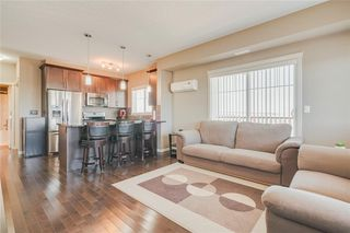 Photo 3: 2401 130 PANATELLA Street NW in Calgary: Panorama Hills Apartment for sale : MLS®# C4294912