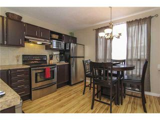 Photo 2: 14 RADCLIFFE Court SE in CALGARY: Radisson Heights Residential Attached for sale (Calgary)  : MLS®# C3600435