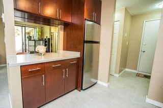"Photo 3: 303 9155 SATURNA Drive in Burnaby: Simon Fraser Hills Condo for sale in ""Mountainwood"" (Burnaby North)  : MLS®# R2042603"