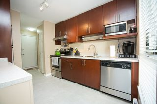 "Photo 2: 303 9155 SATURNA Drive in Burnaby: Simon Fraser Hills Condo for sale in ""Mountainwood"" (Burnaby North)  : MLS®# R2042603"